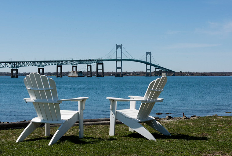 Patio chairs on the U.S. Naval War College campus overlooking the Narragansett Bay and Pell Bridge.