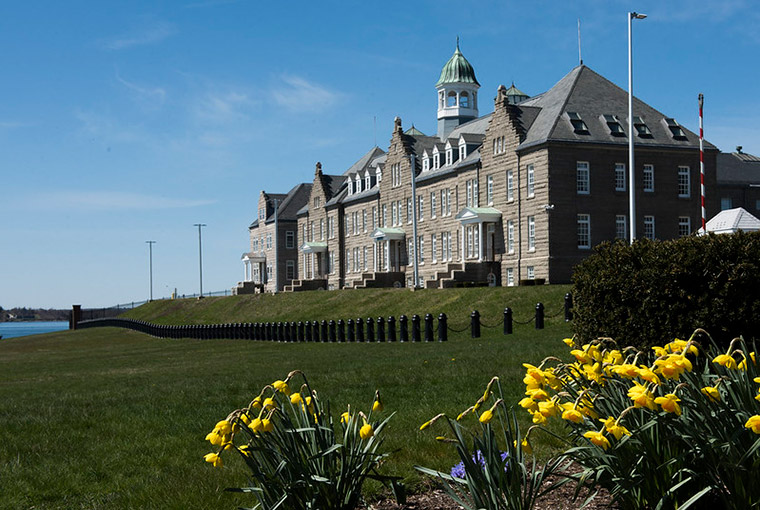 U.S. Naval War College with yellow flowers in spring.