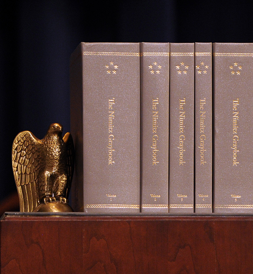 One of three hardbound copies of The Nimitz Graybook sits on display during a digital launch at U.S. Naval War College in Newport, R.I.