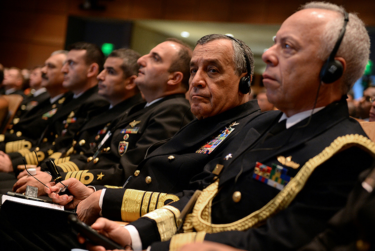 Guests listen to translated remarks through headphones during the Chief of Naval Operations' 21st International Seapower Symposium (ISS) at U.S. Navy War College in Newport, Rhode Island.