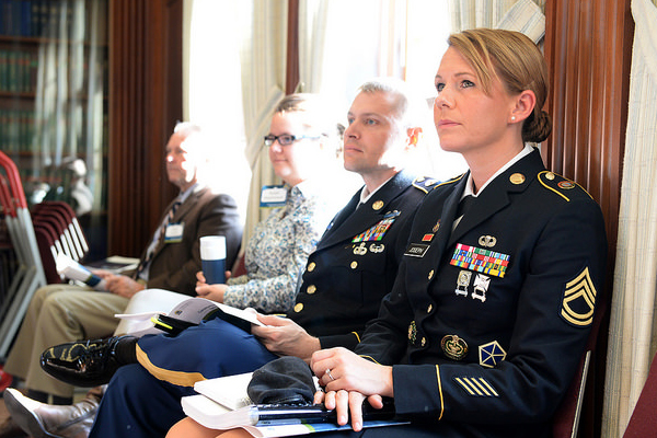 Sgt. 1st Class Tera Vandenheuvel-Joseph, assigned to U.S. Pacific Command in Honolulu, Hawaii, listens to remarks from Adm. Michelle Howard, Vice Chief of Naval Operations, during the 2015 Women, Peace and Security conference at U.S. Naval War College in Newport, Rhode Island.
