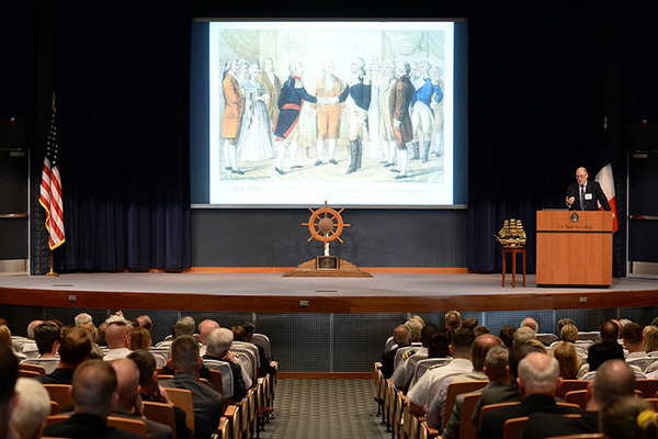 "Miles Young, chairman of Friends of Hermione-Lafayette in America, provides guest speaker remarks to students, staff, faculty and guests during an evening lecture, ""Recreating Our Maritime Heritage,"" at NWC in Newport, Rhode Island."