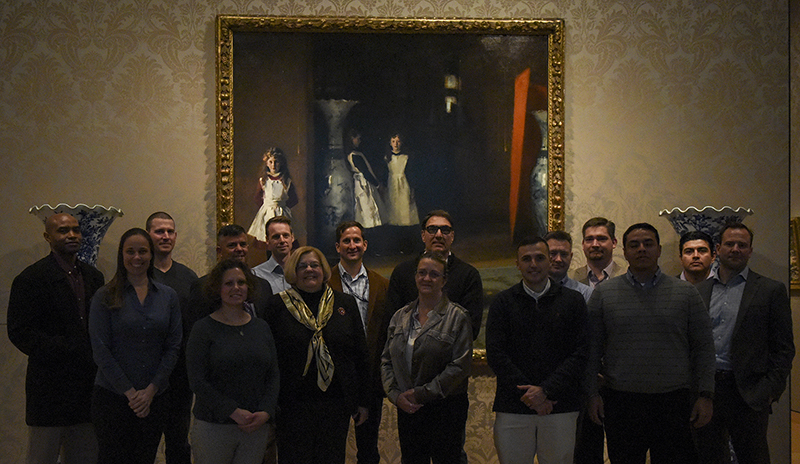 A group of U.S. Naval War College (NWC) students gather at the Boston Museum of Fine Arts for an informative tour of artwork.