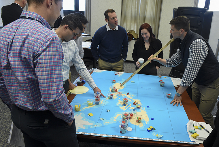 U.S. Naval War College (NWC) students participated in a learning game beta test ran by NWC's Joint Military Operations and Wargaming departments.