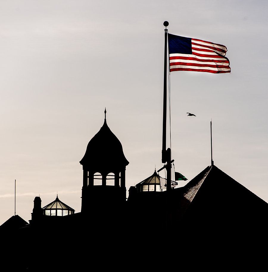 U.S. Naval War College with American flag waving during sunset