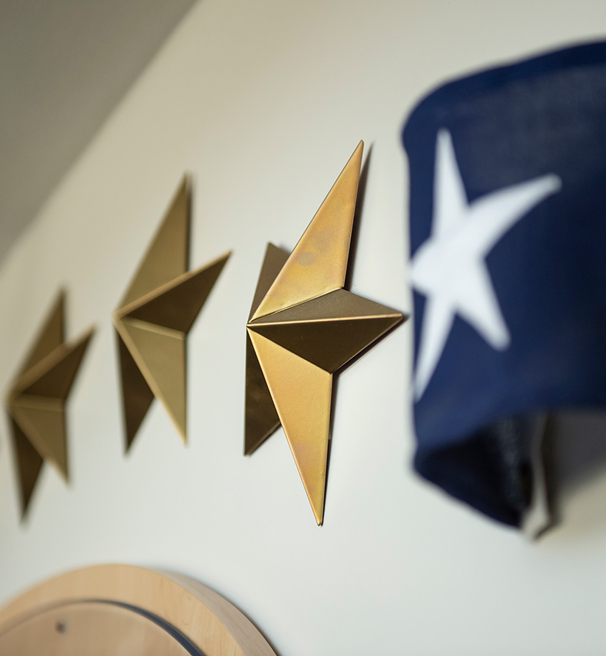 Stars hanging on a wall with a flag.