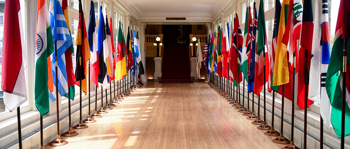 Pringle Hall with international flags at the U.S. Naval War College.