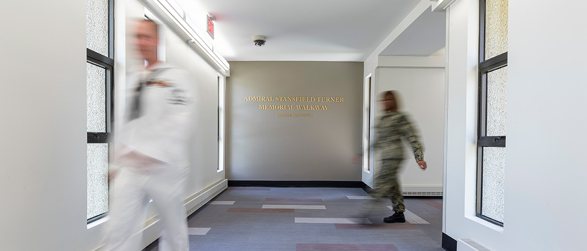 Students walking down hallway at U.S. Naval War College