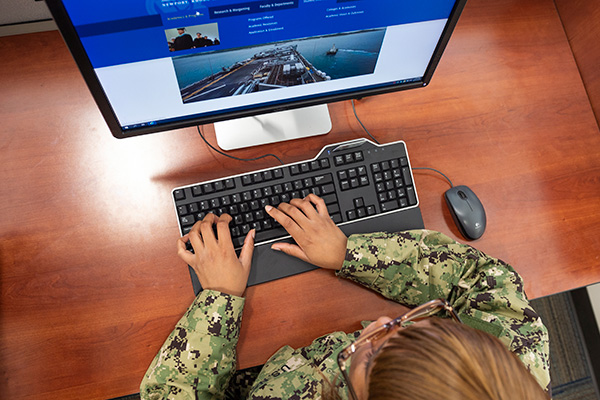 Student using a computer at the U.S. Naval War College