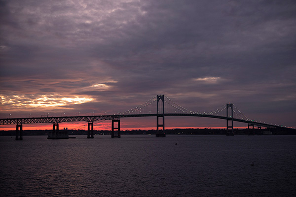 Sunset behind the Newport, Rhode Island Pell Bridge.