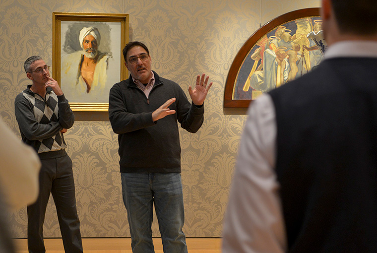 Lt. Col. Terry Brannan, left, listens as Tom Culora, dean of the Center for Naval Warfare Studies, discusses paintings during a Jan. 16 tour of the Boston Museum of Fine Arts.