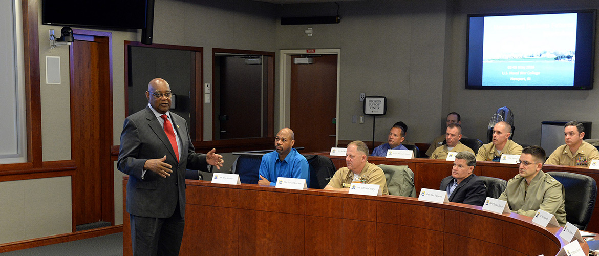 William Bundy, director of U.S. Naval War College's (NWC) Gravely Naval Warfare Research Group, speaks with participants of the Unmanned Systems Workshop held at NWC in Newport, Rhode Island.