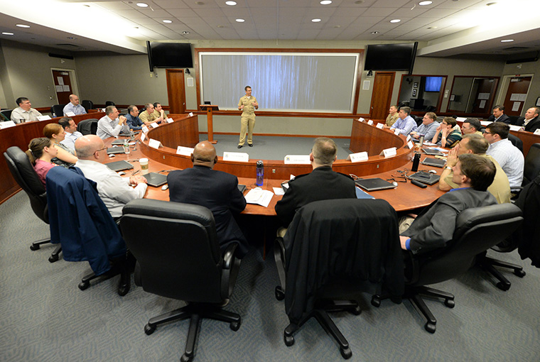 Cmdr. Joe Root, assigned to U.S. Pacific Command (USPACOM), speaks with participants of a Counter-Unmanned Undersea Vehicle (CUUV) capabilities workshop held at U.S. Naval War College in Newport, Rhode Island.