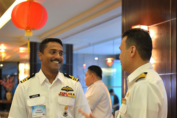 Participants engage in conversation during a concession break at U.S. Naval War College's 16th Regional Alumni Symposium held in the Malaysian capital of Kuala Lumpur.
