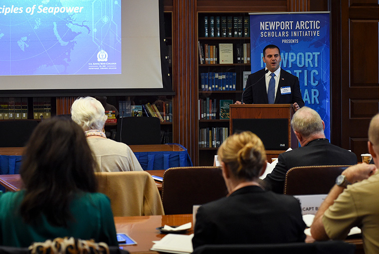 Walter Berbrick, associate professor, U.S. Naval War College's (NWC) Wargaming Department, gives a keynote address during the Newport Arctic Scholars Initiative held at NWC's Mahan Reading Room.