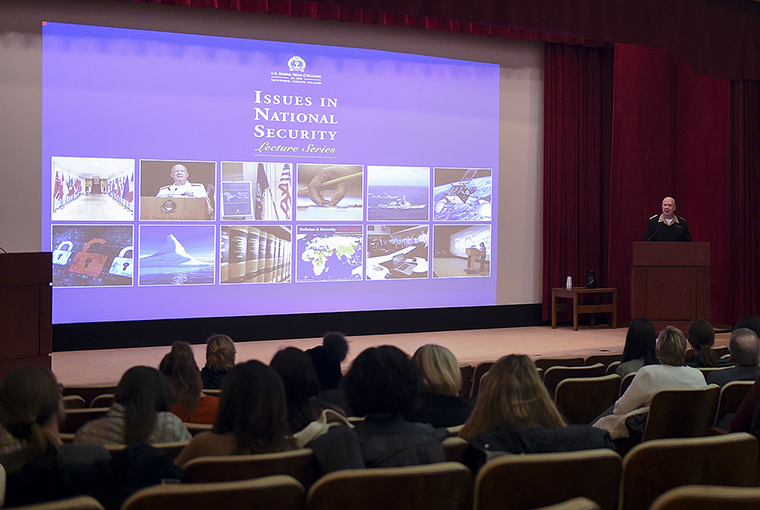 "Rear Adm. Jeffrey A. Harley, president, U.S. Naval War College (NWC) in Newport, Rhode Island provides opening remarks to more than 100 spouses and significant others of NWC staff, faculty, and students at the first of 11 scheduled lectures, in a series titled ""Issues in National Security"" held at NWC."