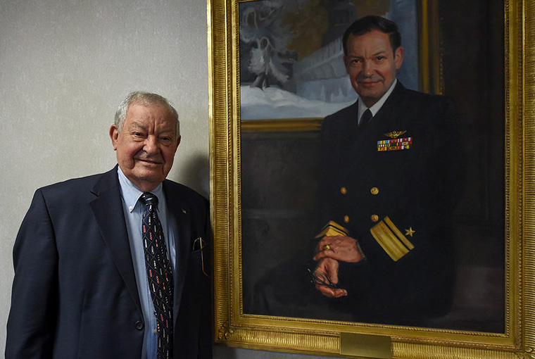 Retired Rear Adm. Ronald J. Kurth, U.S. Naval War College (NWC) president from Aug. 1987 until July 1990, stands aside his official portrait in Conolly Hall at NWC