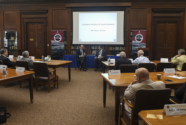Paul Selian, State Street Corporation, (left), with moderator Thomas Sass, addresses a symposium hosted by the Center for Irregular Warfare and Armed Groups (CIWAG) at the school in Newport, Rhode Island.