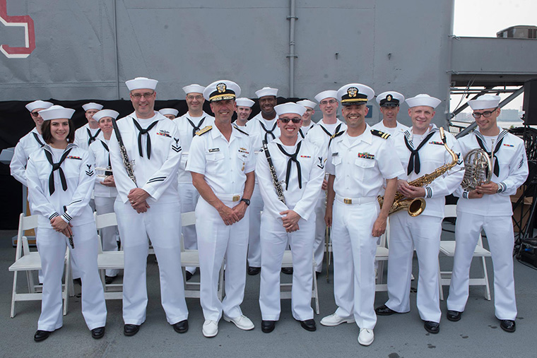 Chief of Naval Operations, Admiral John M. Richardson takes a photo opportunity with the Sailors of Navy Band Northeast.