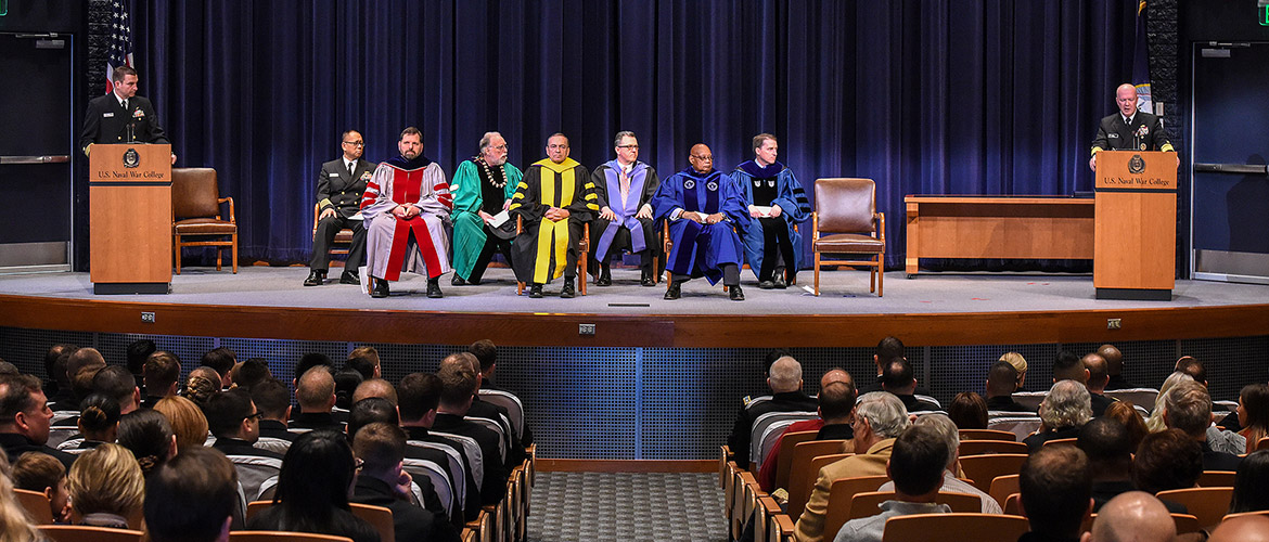 Rear Adm. Jeffrey A. Harley, president, U.S. Naval War College (NWC), speaks to the students, staff, faculty, and guests during a graduation ceremony at NWC.
