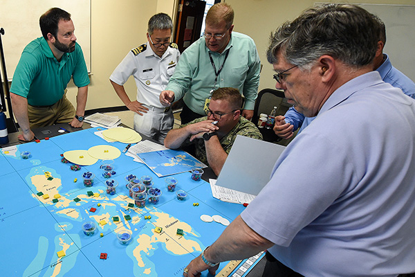 Military officers from various countries participate in the first international wargaming course held at U.S. Naval War College (NWC).