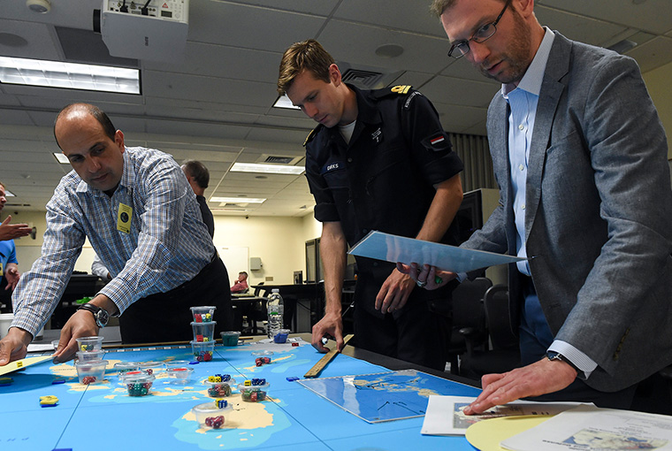 Military officers from various countries participate in the first international wargaming course held at U.S. Naval War College.