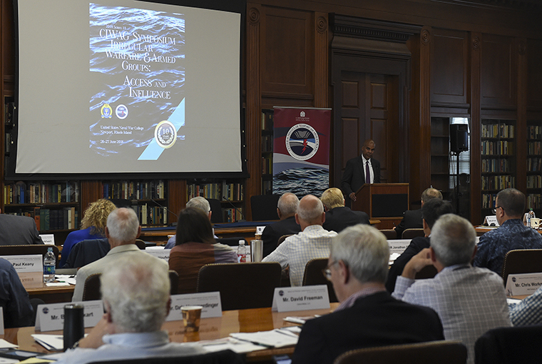 Andrew F. Knaggs, deputy assistant secretary of defense for special operation and combating terrorism, addresses a symposium hosted by the Center for Irregular Warfare and Armed Groups (CIWAG) at U.S. Naval War College (NWC).