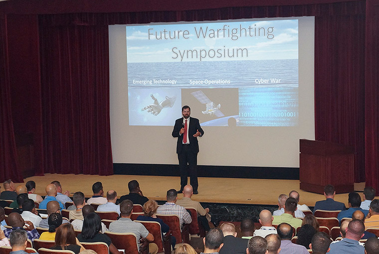Phil Haun, dean of academics at U.S. Naval War College (NWC), speaks during NWC's inaugural Future Warfighting Symposium held at NWC.