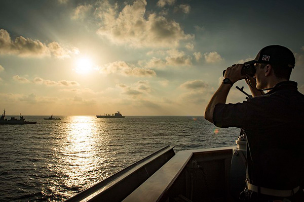 Ensign Jordan Whittle observes the Israeli Navy Sa'ar 5-class corvette INS Lahav.