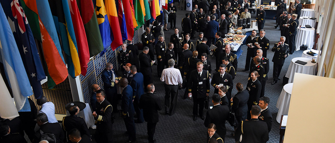 Participants converse during the Chief of Naval Operations' 23rd International Seapower Symposium (ISS) at U.S. Naval War College.