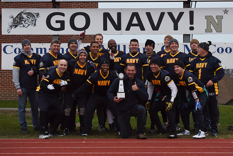 U.S. Naval War College (NWC) students and staff gathered during NWC's annual Army-Navy Flag Football Game. Navy secured bragging rights by defeating Army with a score of 21-14.