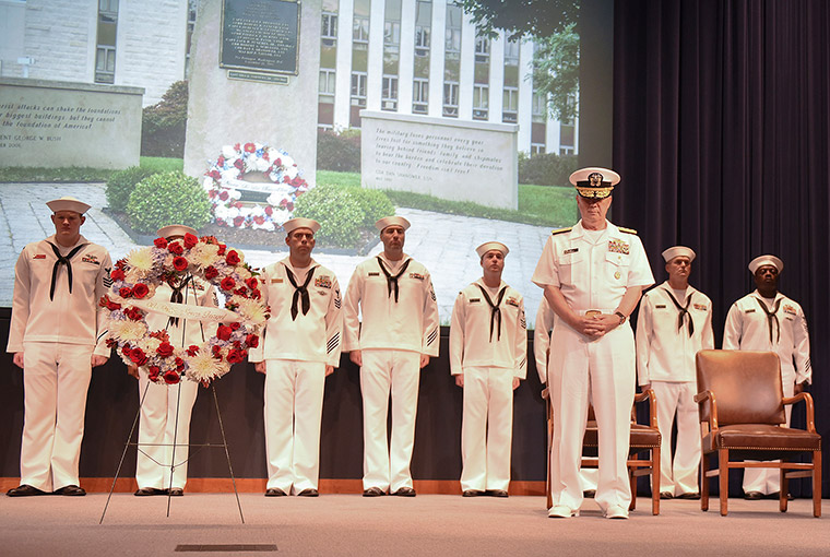 Rear Adm. Jeffrey A. Harley, president, U.S. Naval War College (NWC) bows his head during the closing remarks following a wreath laying at a ceremony to commemorate the 17th anniversary of the 9/11 attacks