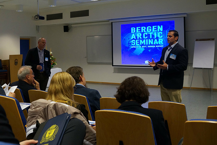 Professors Lars Saunes (left), former chief of Royal Norwegian Navy, and Walter Berbrick (right), co-lead scholars for the Newport Arctic Scholars Initiative discuss important arctic issues at the final NASI symposium held in Bergen, Norway, April 8-9, 2019.