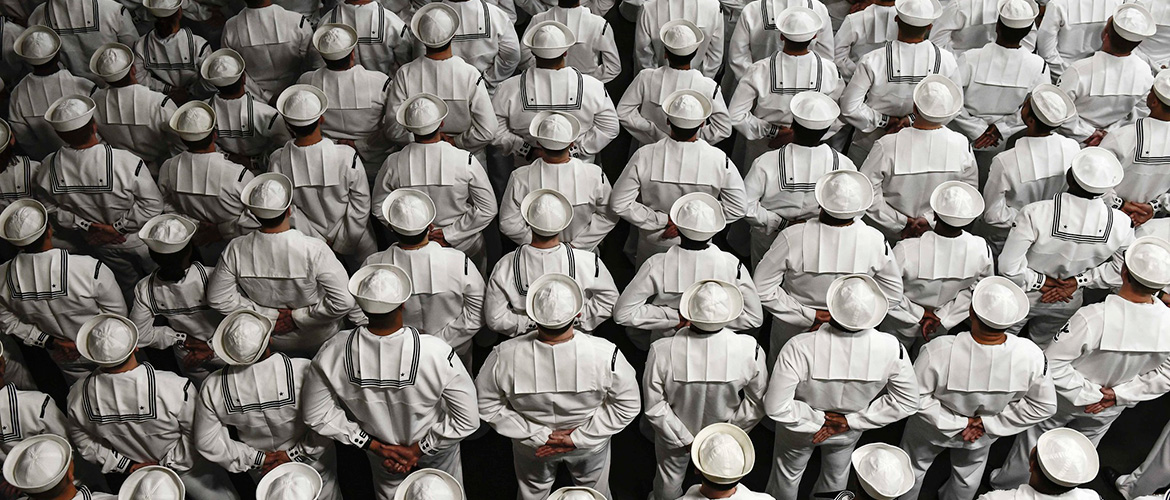 Sailors stand at parade rest during a change of command ceremony aboard the amphibious assault ship USS Wasp.