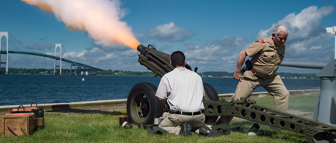 Newport Artillery Company fires a gun salute for Secretary of the Navy Richard V. Spencer during a graduation ceremony held at U.S. Naval War College's (NWC) Dewey Field in Newport, R.I.