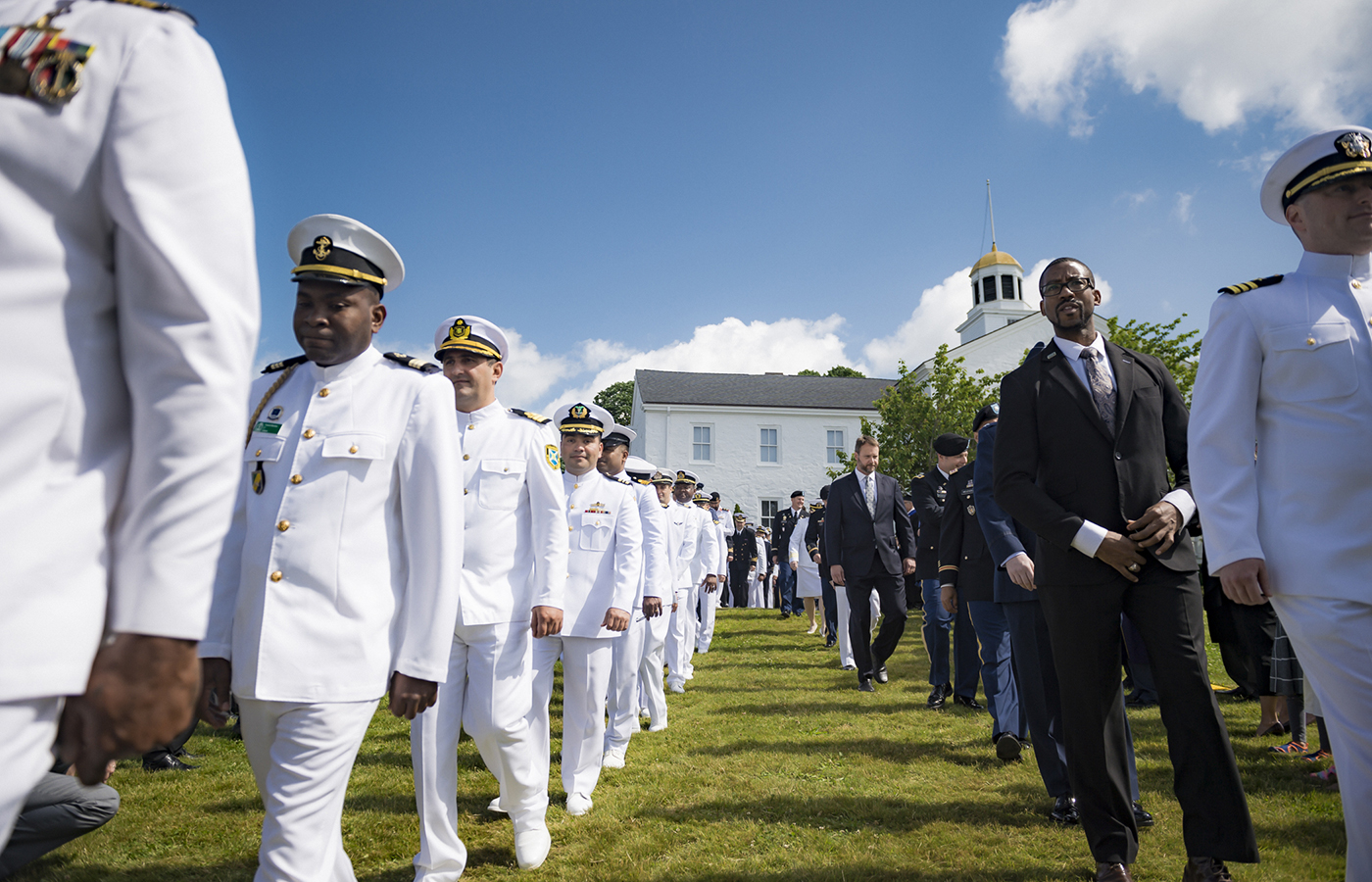 Students of U.S. Naval War College's 2019 graduating class participate in a commencement ceremony on Dewey Field in Newport, R.I., June 14.