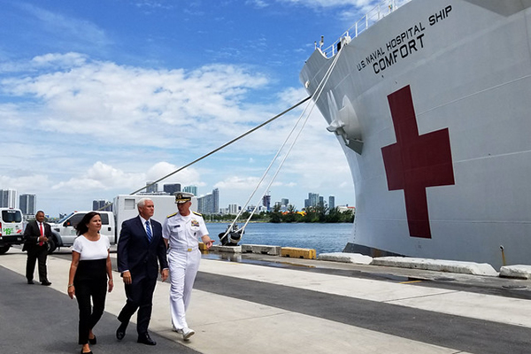 Vice President Mike Pence, center, second lady Karen Pence, and Adm. Craig S. Faller, commander of U.S. Southern Command, visit the hospital ship USNS Comfort (T-AH 20).