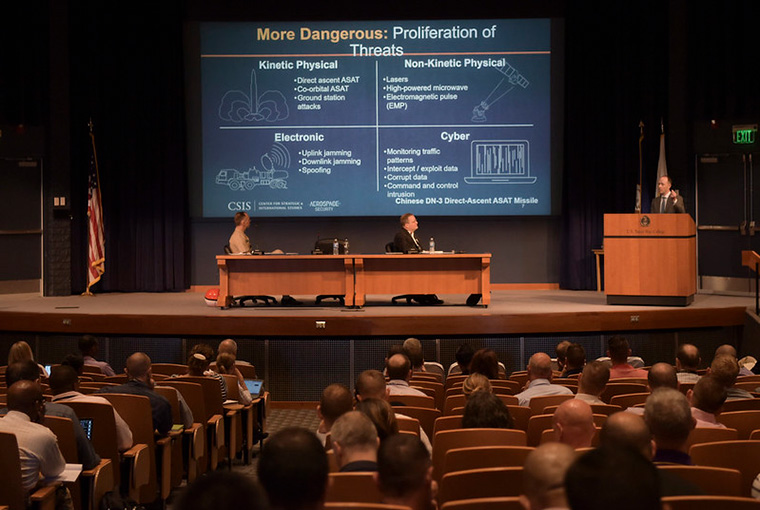 "Todd Harrison speaks to U.S. Naval War College students during the panel ""Milspace Operation and Organization"" during the Future Warfighting Symposium held in the college's Spruance Auditorium, Aug. 8."