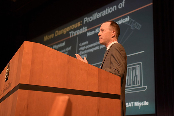 """Todd Harrison speaks during the panel """"Milspace Operation and Organization"""" during the Future Warfighting Symposium held at U.S. Naval War College, Aug. 8."""