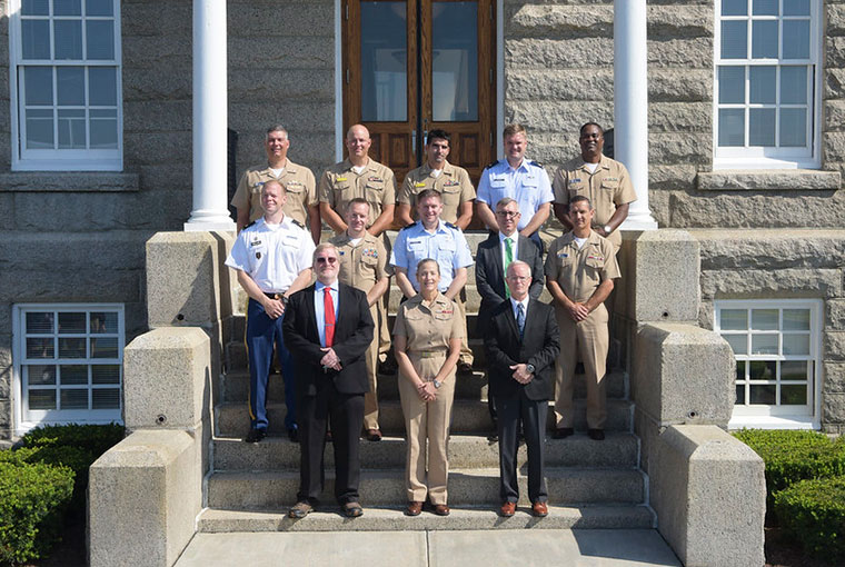 Rear Adm. Shoshana S. Chatfield (front row, center), president, U.S. Naval War College,     stands with faculty and graduates of the college's Advanced Strategist Program on the steps of Luce Hall, Aug. 15