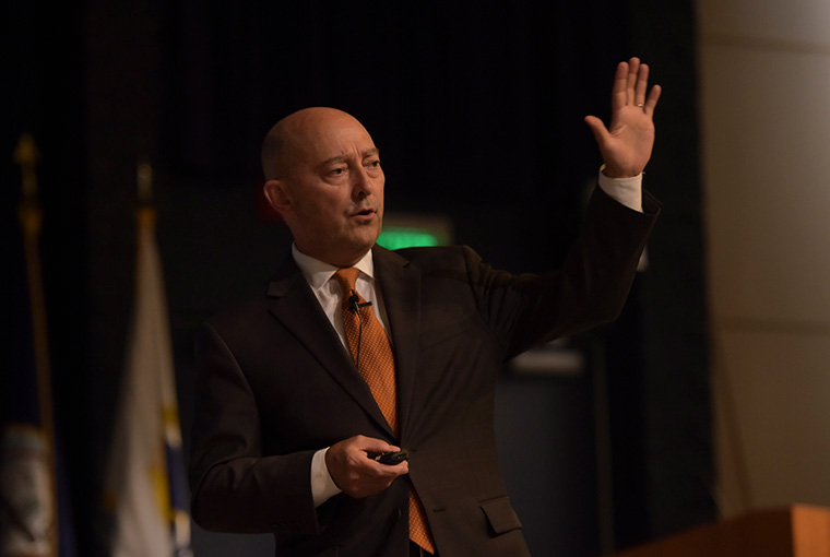 "Retired Adm. James Stavridis, guest speaker, gives a speech at the U.S. Naval War College during the second annual Stansfield Turner Lecture Series event August 16. The speech titled ""21 Century Security: Risk and Opportunity"", included topics on violent extremism and strategic thinking."