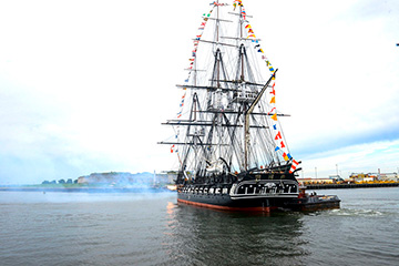 USS Constitution performs a 21-gun.