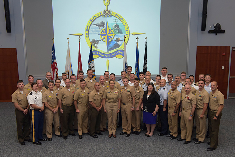 U.S. Naval War College's Maritime Advanced Warfighting School (MAWS) 2019 graduating class gathers for a group photo at the conclusion of the graduation ceremony.