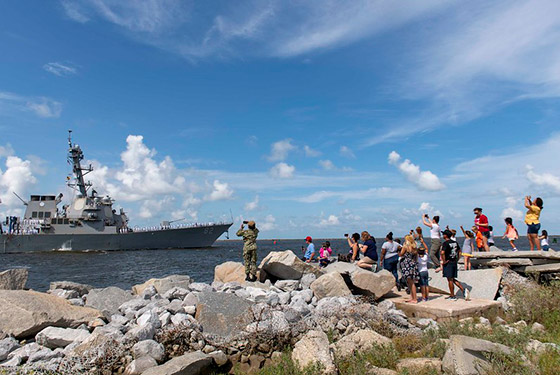Families wave as the Arleigh Burke-class guided-missile destroyer USS Lassen (DDG 82) departs Naval Station Mayport.