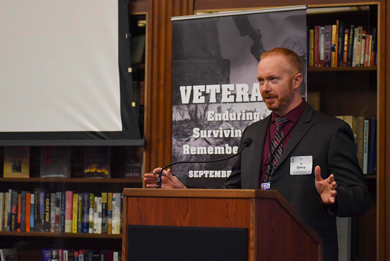 """J. Ross Dancy, assistant professor, U.S. Naval War College (NWC), delivers opening remarks for the conference """"Veterans: Enduring, Surviving, and Remembering War,"""" at NWC on Sept. 12."""
