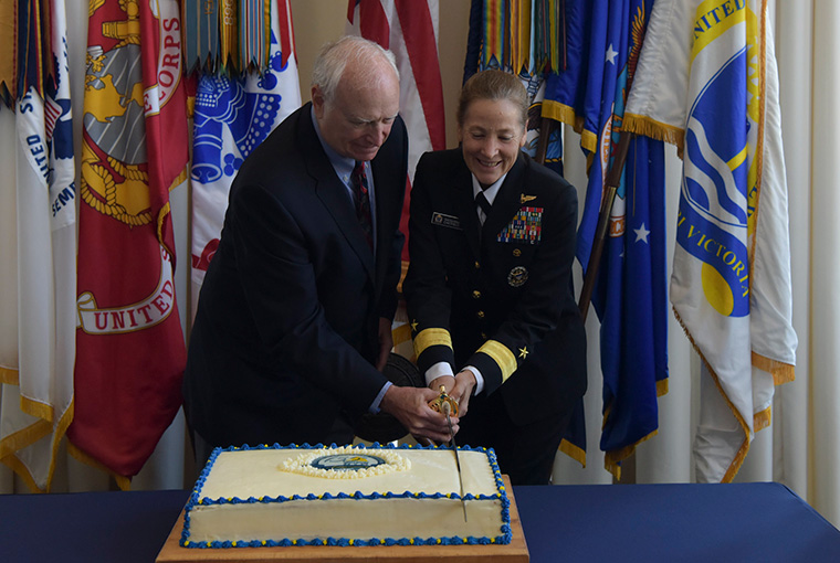 Rear Adm. Shoshana S. Chatfield, president, U.S. Naval War College (NWC), and former president retired Rear Adm. James Stark cut a cake in celebration of NWC's 135th anniversary, Oct. 7.