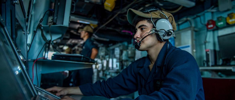 Operations Specialist Seaman Apprentice Reuben Aguilar mans a bridge watch aboard the guided-missile destroyer USS Bainbridge.