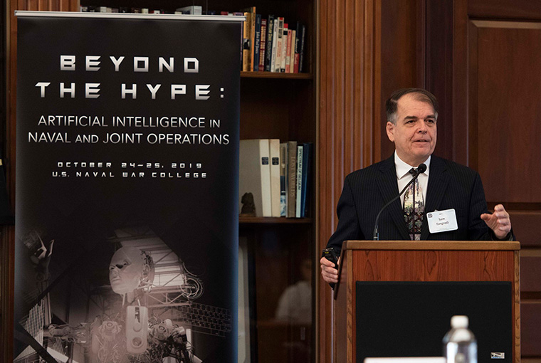 "Samuel Tangredi, professor, U.S. Naval War College (NWC), delivers an opening speech during the ""Beyond the Hype: Artificial Intelligence in Naval and Joint Operations"" conference at NWC, Oct. 24."
