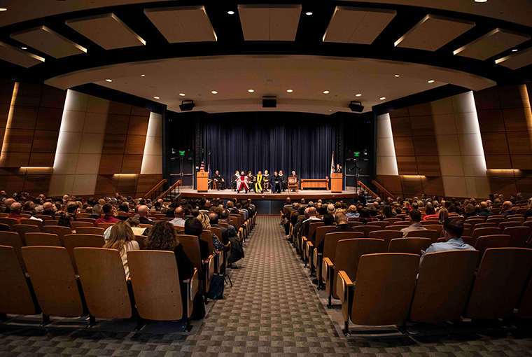 Rear Adm. Shoshana Chatfield, president, U.S. Naval War College, gives a speech during a graduation ceremony held at Spruance Auditorium on Nov. 13. Forty students graduated during the ceremony.