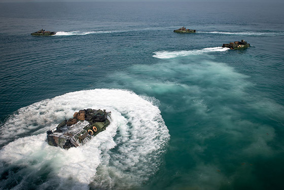 Amphibious assault vehicles launch from the well deck of the amphibious dock landing ship USS Oak Hill (LSD 51) during well deck operations, Feb. 23, 2020.
